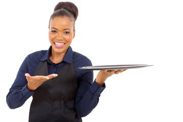 afro american waitress holding empty tray