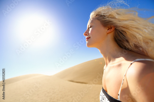 Sun skin care woman enjoying desert sunshine