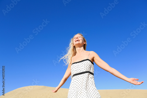 Happy woman enjoying sun and freedom