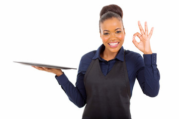 young african american waitress giving ok hand sign