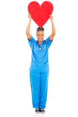 african american female doctor holding heart