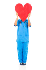 african nurse hiding her face behind heart shape