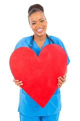 cute african doctor holding heart