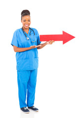 black doctor with direction arrow sign