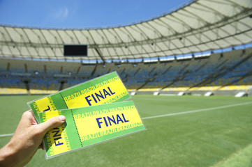 Soccer Fan Holding Two Brazil Final Tickets at the Stadium