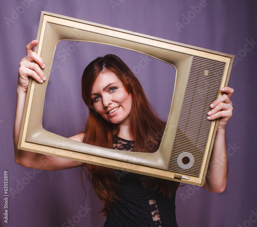 teen girl child framed television smiling on gray