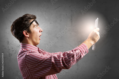Guy using tablet pc