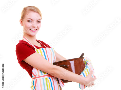 Housewife or chef in kitchen apron with pot of soup isolated
