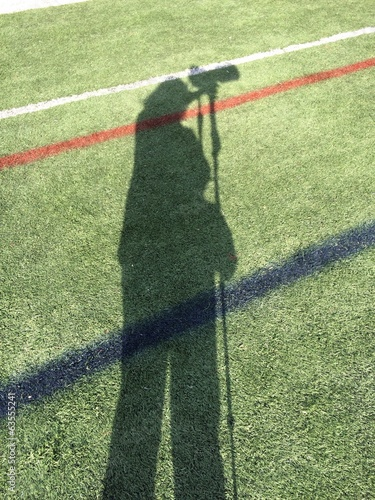 Shadow of a sports photographer