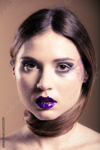 Portrait of girl woman with long hair creative makeup