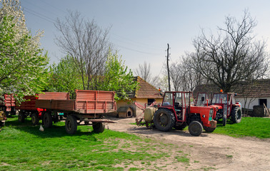 Tractors and trailers on the old fashioned farm