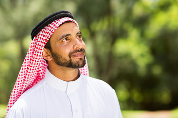 middle eastern man looking up
