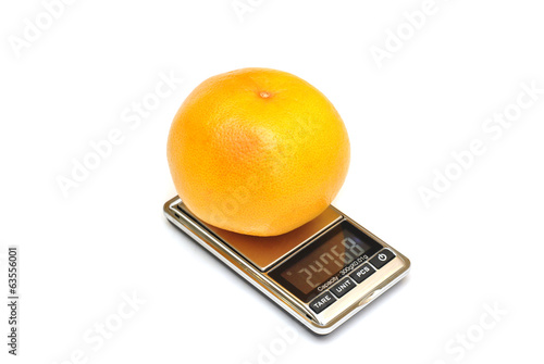 large orange on electronic scales with digital display