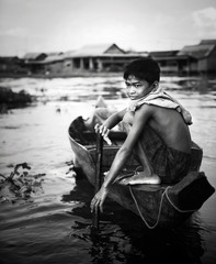 Boy Traveling by Boat in Floating Village, Cambodia