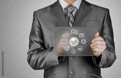Businessman pressing icon  glass tablet