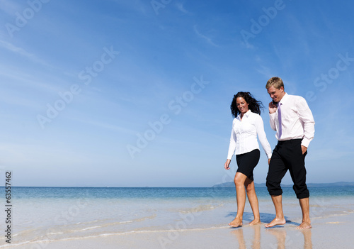 Business Colleagues Walking on the Beach