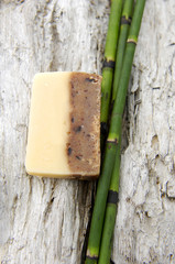 Nature soap with thin bamboo grove on old wood