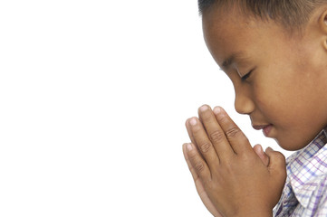 Little Child praying over white background