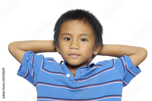 Little boy with arms on ears and closed eyes isolated