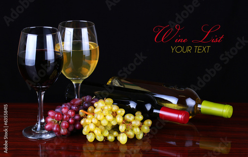 Wine Bottles and Glasses of Wine over black background.