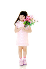 Cute asian girl posing with flowers