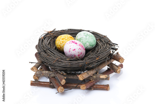 nest with easter eggs, isolated
