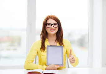 smiling student girl in eyelgasses with tablet pc