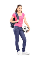 Young girl holding a football