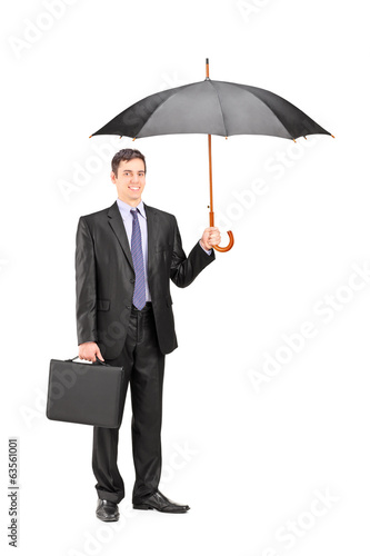 Man holding an umbrella and a briefcase