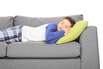 Little boy sleeping on couch
