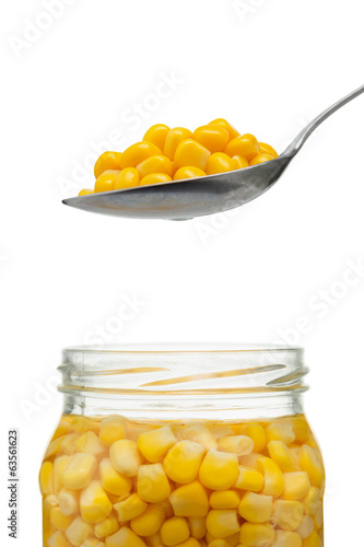 Open jar with sweetcorn and a spoon