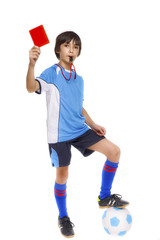 Kid in sportswear holding soccer ball and giving red card isolat