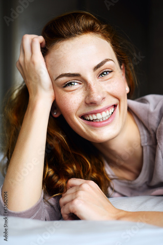 Portrait of charming beautiful girl in bed