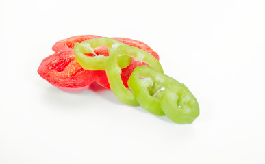 Slice of peppers isolated on white