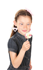 Portrait of beautiful little girl with lollipop isolated