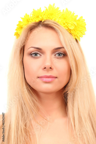 Beautiful young woman with bright yellow flowers in her hair
