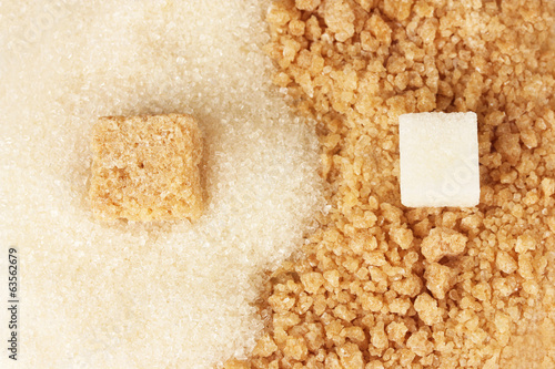 Pattern of white sugar and brown sugar close-up