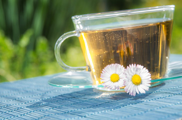 Tea chamomile. Glass cup of healthy drink