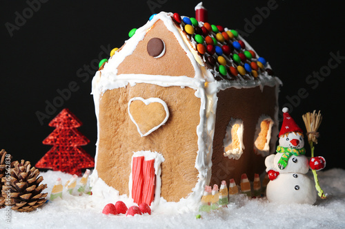 Gingerbread house on black background