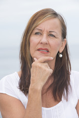 Concerned mature woman portrait outdoor
