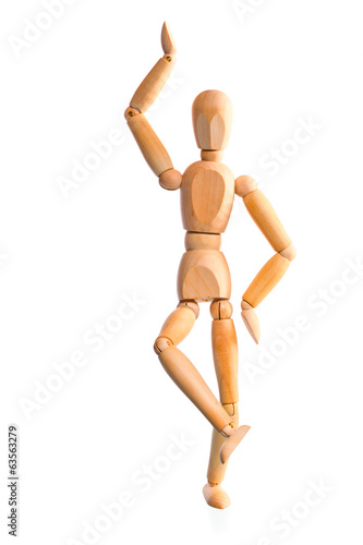 wood mannequin holds the balance on one leg