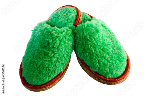 natural woolen slippers on white background