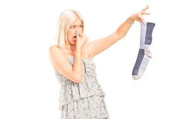 Woman holding a stinky sock
