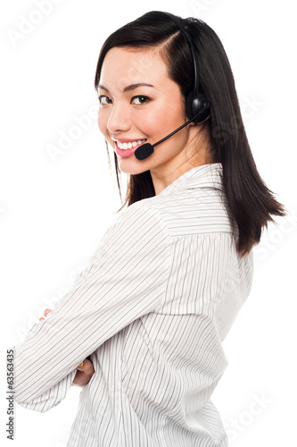Smiling young call center executive