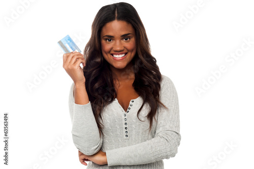 Pretty woman showing credit card to camera