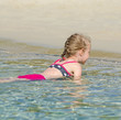 Little girl relaxing in the ocean.
