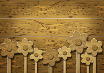 Wooden flowers over wooden background