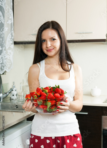 woman with  plate of strawberries