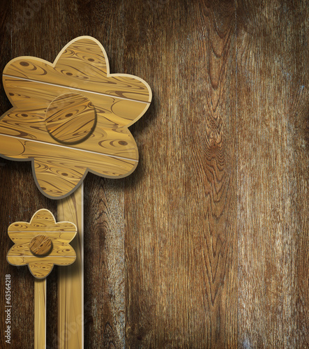 Wooden flowers on wooden surface