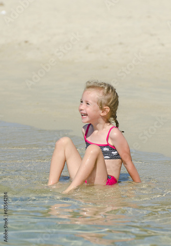 Little girl having fun on the beach.